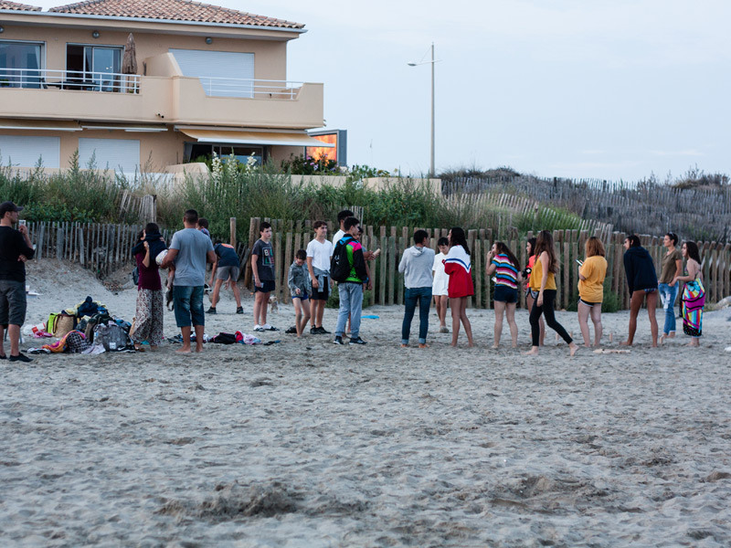 students and host families on the beach